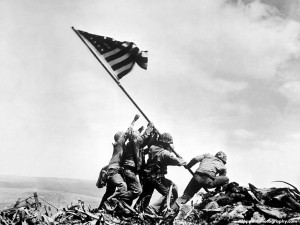 Five Marines and a Navy Corpsman raised the U.S. flag on Mount Suribachi in a photo that won the Pulitzer Prize. Uploaded by wallpaperesphotography.com.