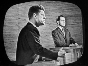 John Kennedy and Richard Nixon compete in the first televised debate.