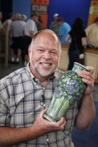 A man shows off a treasure on Antiques Roadshow